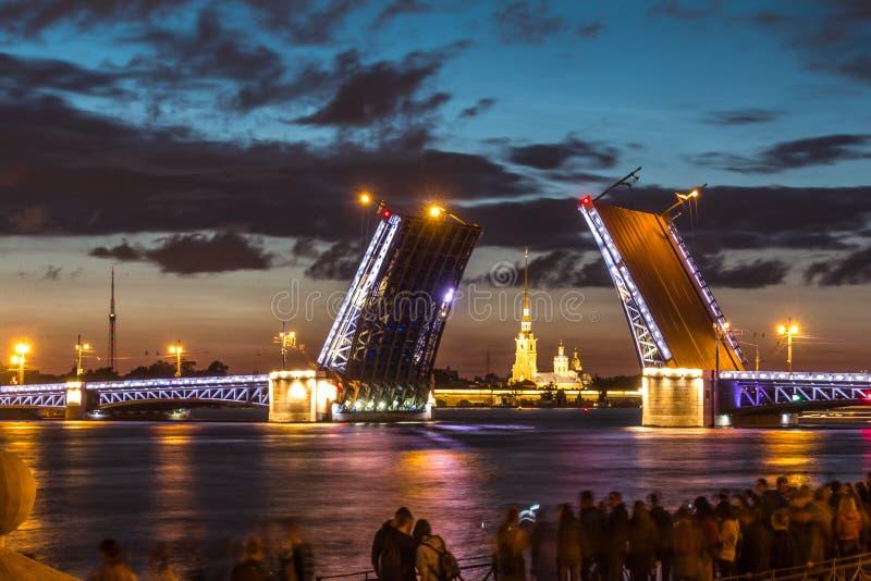 The Famous Bridges Of St. Petersburg. Drawbridge. Night city. City on Neva river. Palace bridge. Palace embankment. The city lights at night. Northern capital royalty free stock photos