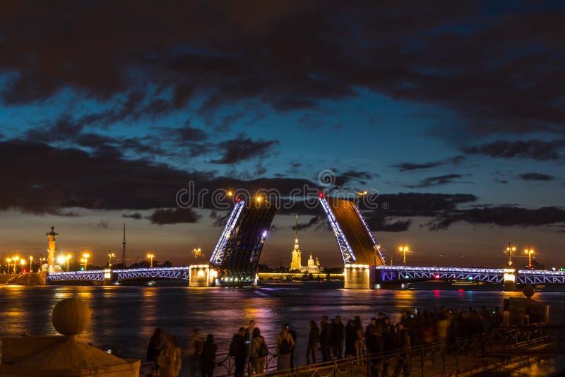 The Famous Bridges Of St. Petersburg. Drawbridge. Night city. City on Neva river. Palace bridge. Palace embankment. The city lights at night. Northern capital royalty free stock images