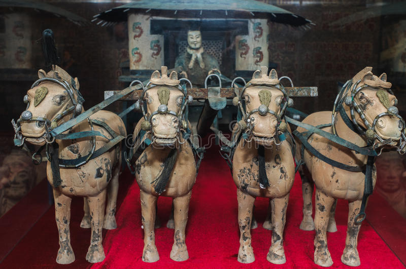 Famous bronze chariot in Xian, China. The famous bronze chariot of China's first emperor Qin Shihuang. The bronze chariot is part of the terracotta army museum stock images