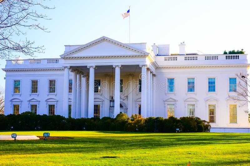 The famous building in the US America, the White House. The US presidential house of the White house in Washington DC with green lawn and American flag on the stock image