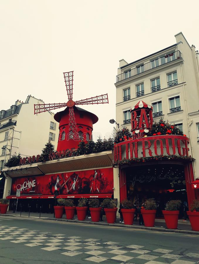 Moulin Rouge. The famous cabaret Moulin Rouge, built in 1889, located in th Paris red-light district close to Montmartre of Pigalle on boulevard Clichy in the stock photo