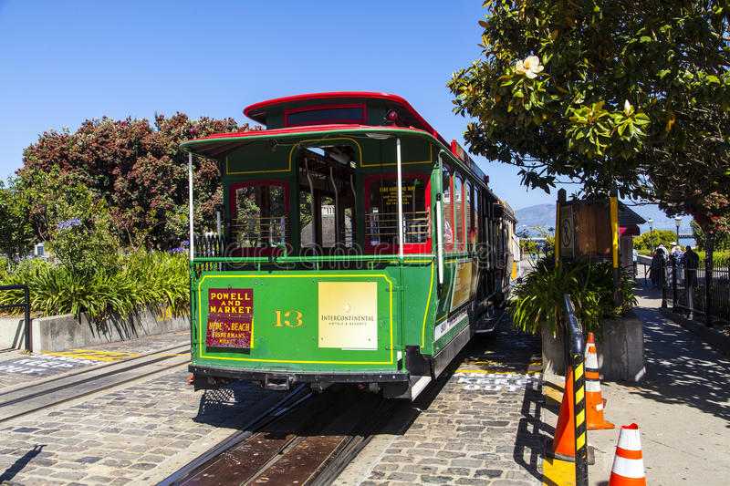 Famous Cable Car Bus in Powell. SAN FRANCISCO - JUNE 20: Famous Cable Car in Powell and Market street on June 20, 2012 in San Francisco, California. Cable car stock image