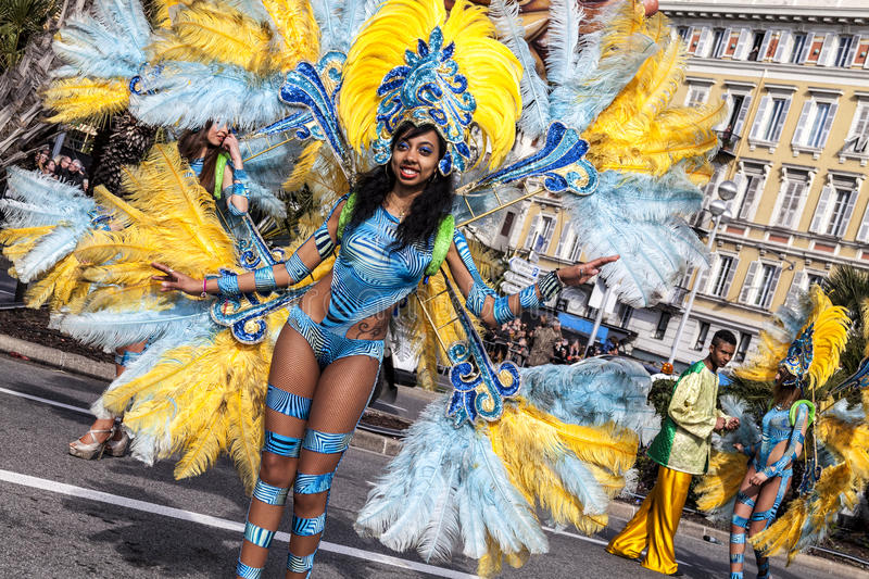 Famous Carnival of Nice, Flowers` battle. A woman in costume dancing on carnival stock images