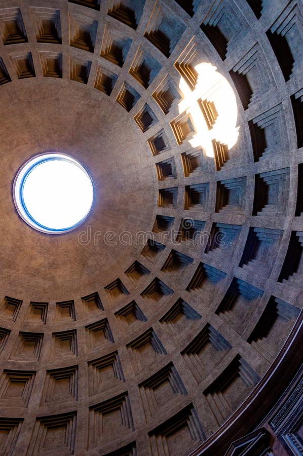 The famous cassette ceiling dome of Pantheon temple of all the gods with wide open rotunda on the top. Sunlight rays penetrating. Rome, Italy - November 18, 2018 royalty free stock images