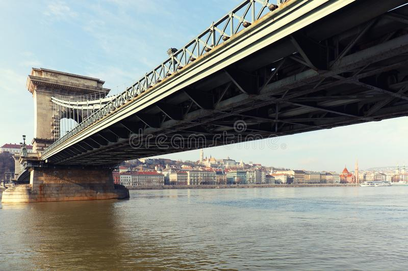 The famous Chain Bridge across the Danube river. The Buda Castle is in background, Budapest, Hungary, Europe. The Szechenyi Chain Bridge Széchenyi lánch royalty free stock image
