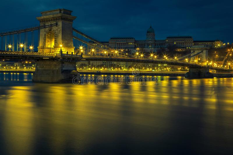 Famous Chain bridge and Buda castle at dawn, Budapest, Hungary. Well known European travel location. Beautiful night cityscape panorama with stunning illuminated stock images
