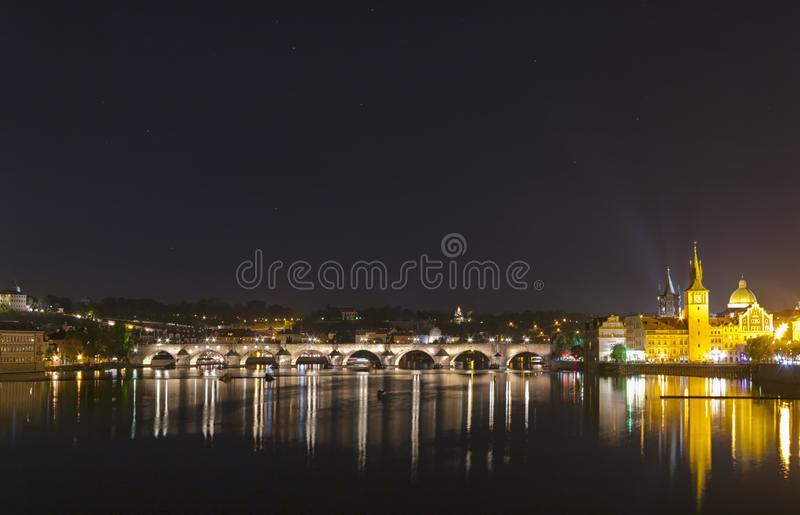 Famous Charles Bridge at night. View of the famous Charles Bridge illuminated at night. Charles Bridge is a historic gothic-style stone bridge that crosses the royalty free stock photos