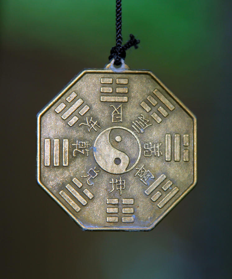 Famous chinese sign Yin and Yang surrounded by Trigrams and hieroglyphs stock photos