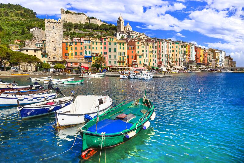 Traditional colorful houses ,boats and turquoise sea,Portovenere village,Cinque Terre,Liguria,Italy. royalty free stock image