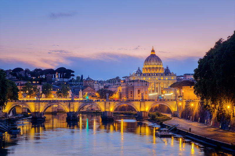 Famous citiscape view of St Peters basilica in Rome at sunset. Italy royalty free stock photo
