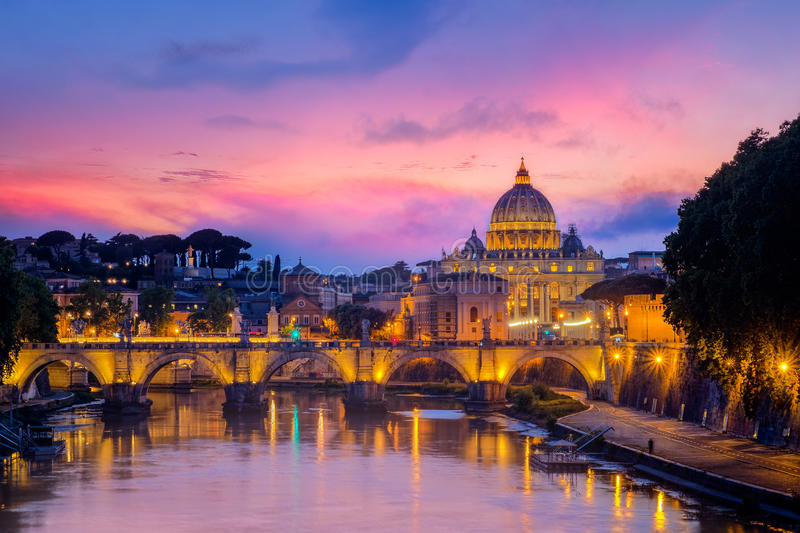 Famous cityscape view of St Peters basilica in Rome at sunset. Italy stock image