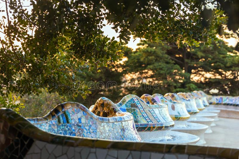 Famous colorful bench in Park Guell designed by Antoni Gaudi in Barcelona. Spain royalty free stock image