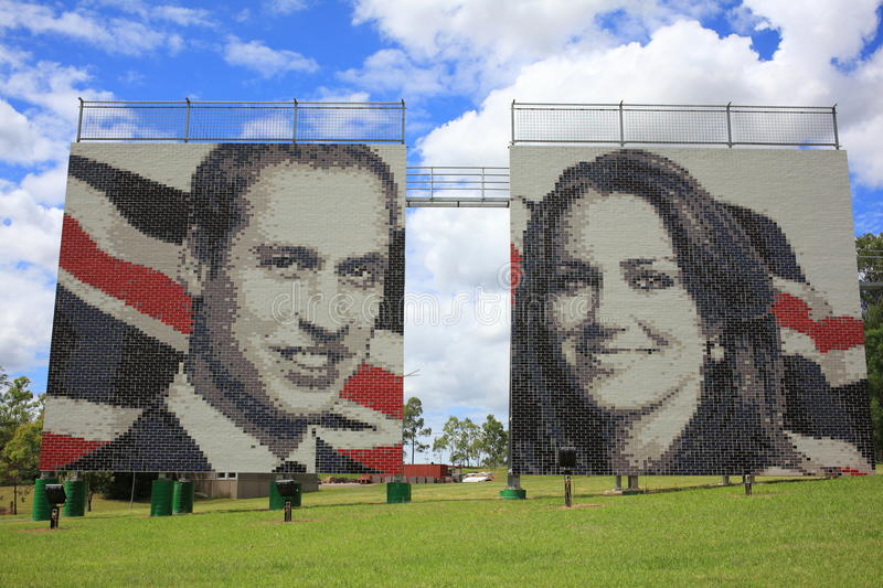 Prince William and Kate on brick wall. The famous couple Prince William and his wife Kate, Duke and Duchess of Cambridge, portrayed on a huge brick wall in royalty free stock image