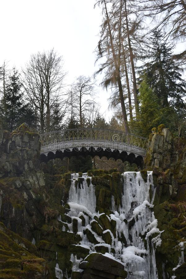 Famous devil`s bridge with beautiful landscape at World Cultural Heritage Herkules in Kassel, Wilhelmshöhe, Germany royalty free stock photo