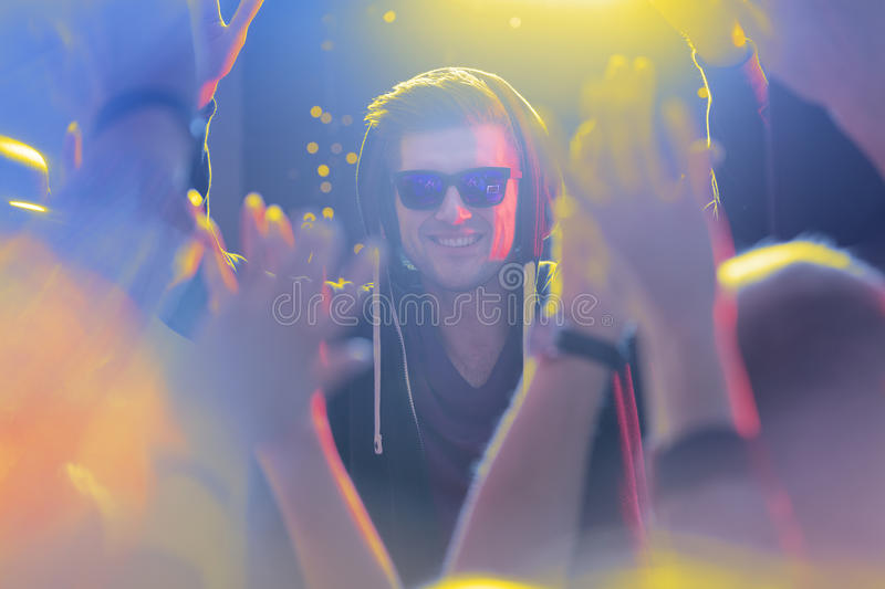 Famous dj and fans. Famous dj and his fans during concert at club royalty free stock images