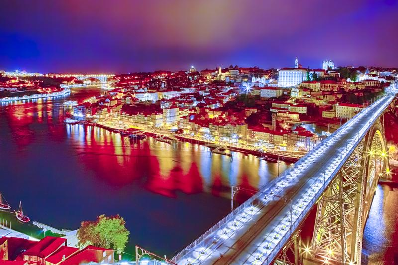 Famous Dom Luis I Bridge in Porto City in Portugal. Against Old City  at Blue Hour royalty free stock images