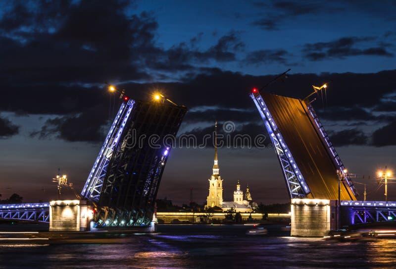 The famous drawbridges of St. Petersburg. The Famous Bridges Of St. Petersburg. Drawbridge. Night city. City on Neva river. Palace bridge. Palace embankment royalty free stock photo