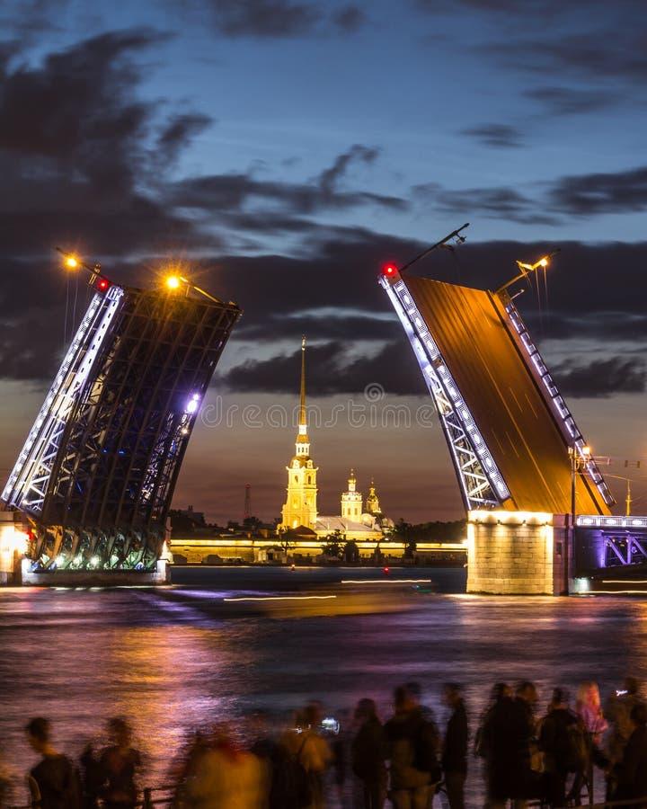 The famous drawbridges of St. Petersburg. The Famous Bridges Of St. Petersburg. Drawbridge. Night city. City on Neva river. Palace bridge. Palace embankment stock image