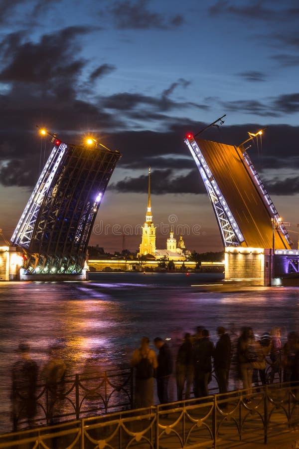 The famous drawbridges of St. Petersburg. The Famous Bridges Of St. Petersburg. Drawbridge. Night city. City on Neva river. Palace bridge. Palace embankment stock images