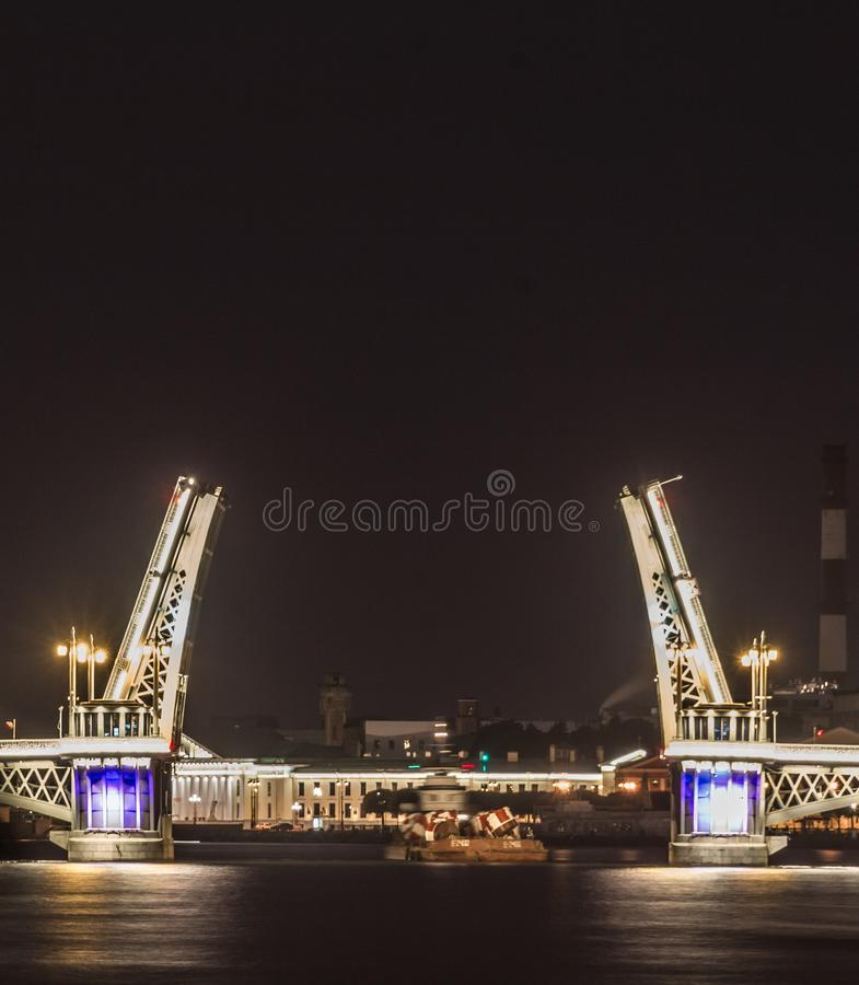 The famous drawbridges of St. Petersburg. The Famous Bridges Of St. Petersburg. Drawbridge. Night city. City on Neva river. Palace bridge. Palace embankment royalty free stock image