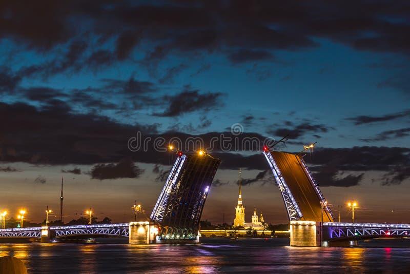 The famous drawbridges of St. Petersburg. The Famous Bridges Of St. Petersburg. Drawbridge. Night city. City on Neva river. Palace bridge. Palace embankment royalty free stock photography