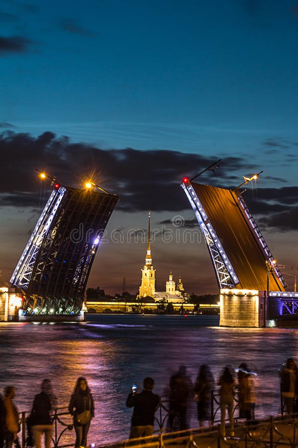 The famous drawbridges of St. Petersburg. The Famous Bridges Of St. Petersburg. Drawbridge. Night city. City on Neva river. Palace bridge. Palace embankment royalty free stock photos