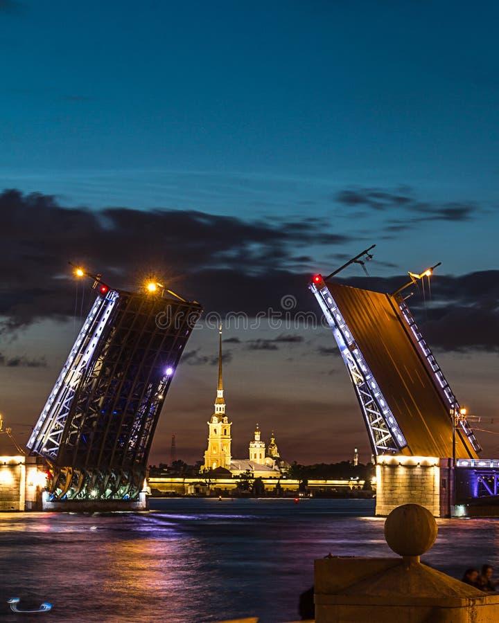 The famous drawbridges of St. Petersburg. The Famous Bridges Of St. Petersburg. Drawbridge. Night city. City on Neva river. Palace bridge. Palace embankment stock photos