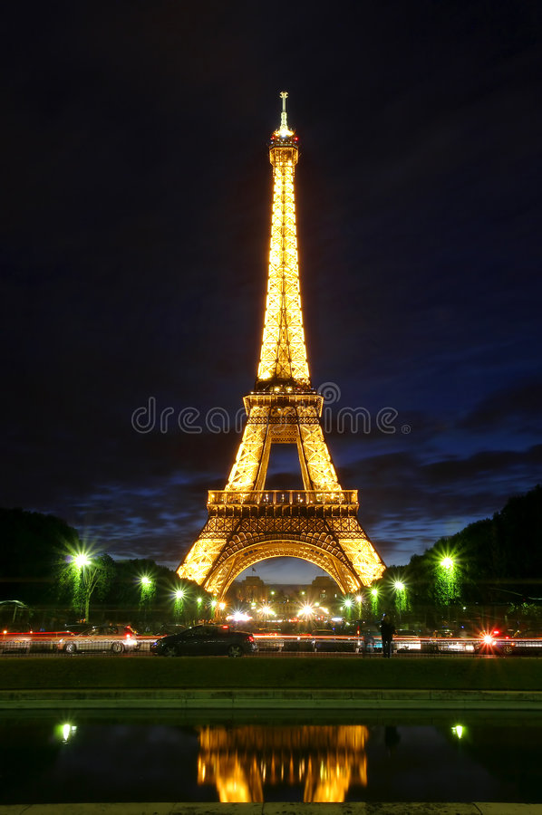 Famous Eiffel Tower with illumination on in Paris. stock photos