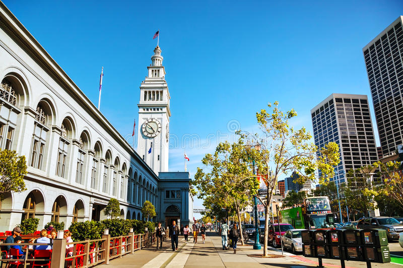 Famous ferry building on April 24, 2014 in San Francisco, California. SAN FRANCISCO - APRIL 24: Famous ferry building on April 24, 2014 in San Francisco royalty free stock photography