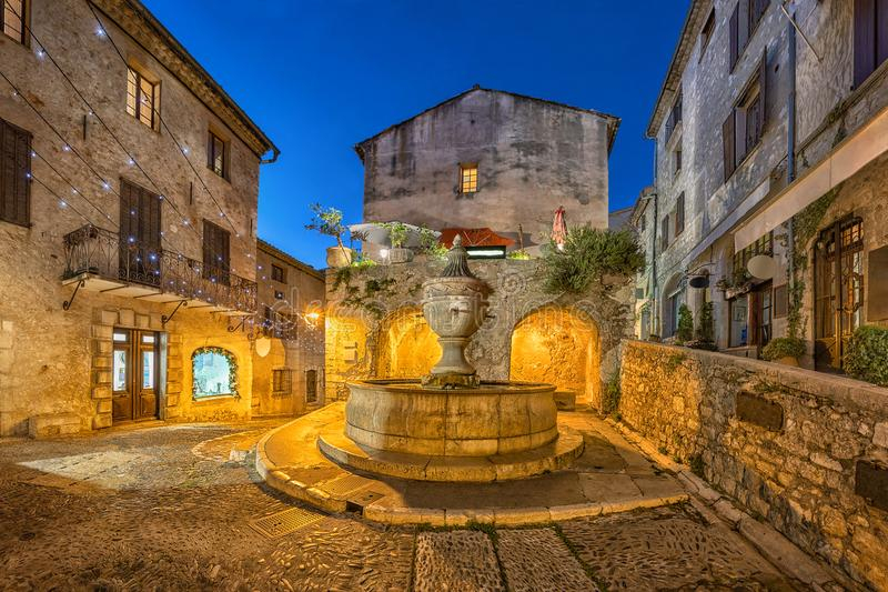 Famous fountain at dusk in Saint Paul de Vence, France royalty free stock image
