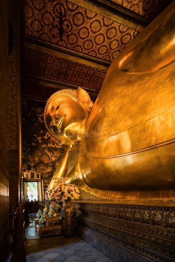 Famous golden reclining buddha statue at wat pho bangkok thailand royalty free stock images