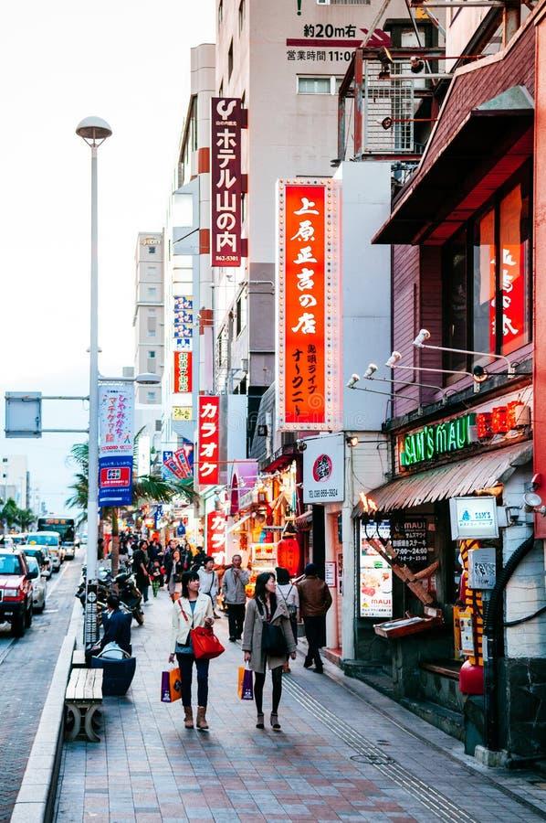 Famous Heiwadori street at Kokusai street many souvenir shops. JAN 28, 2018 Naha, Okinawa, JAPAN : Famous Heiwadori street at Kokusai street. There are many food stock image