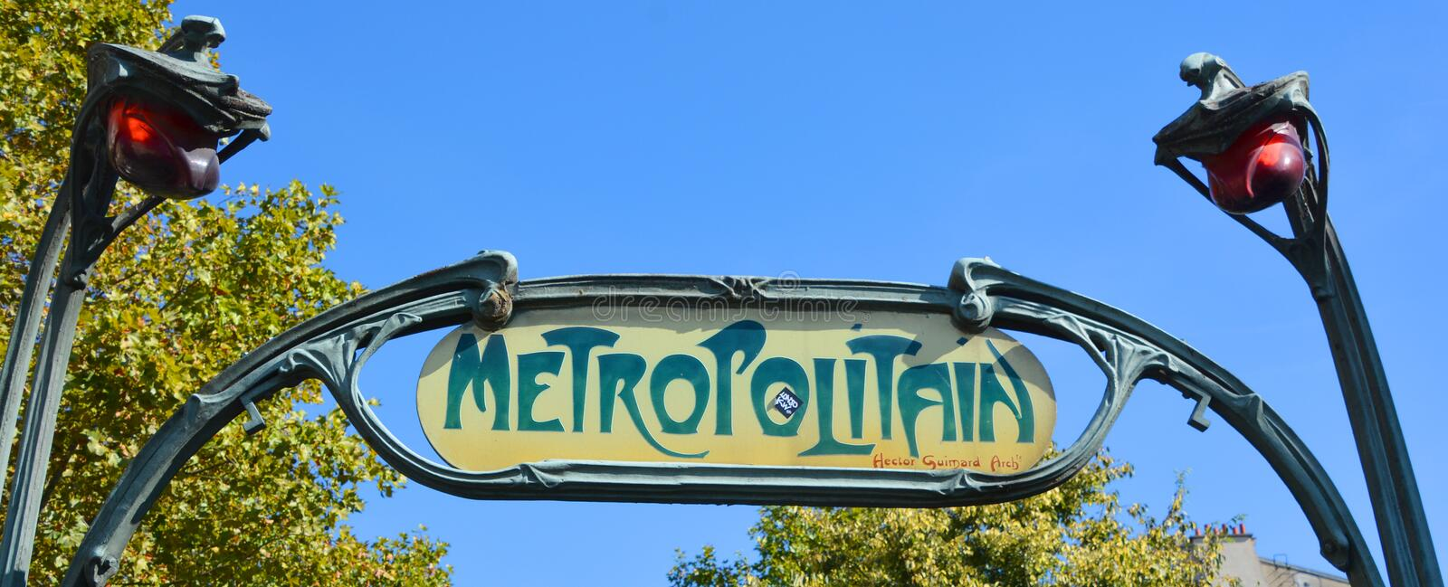 Famous historic Art Nouveau entrance sign. PARIS FRANCE OCTOBER 15, 2014: Famous historic Art Nouveau entrance sign for the Metropolitain underground railway stock photography