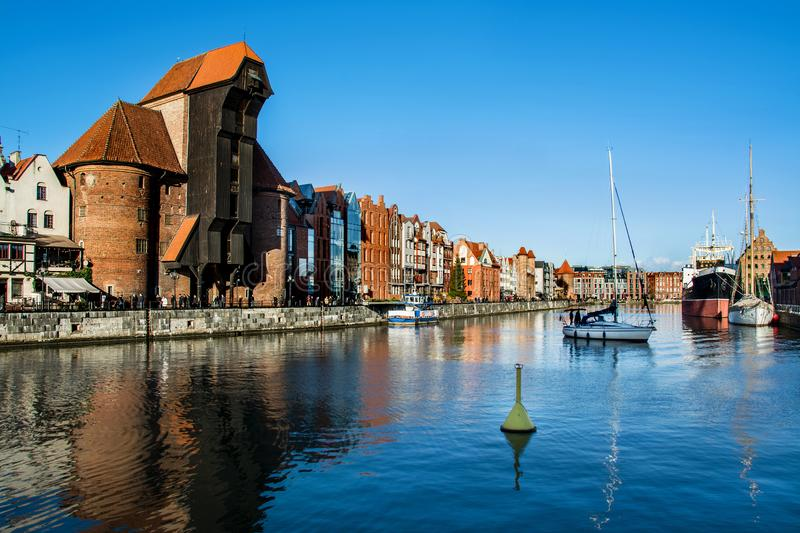 Famous historic Medieval port Crane Żuraw / Krantor - one of the Gdańsk water gates. Sunny morning on the Motlava River. Old tow. N Gdansk Gdańsk / royalty free stock photos