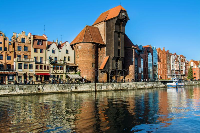 Famous historic Medieval port Crane Żuraw / Krantor - one of the Gdańsk water gates. Sunny morning on the Motlava River. Old tow. N Gdansk, Poland royalty free stock images