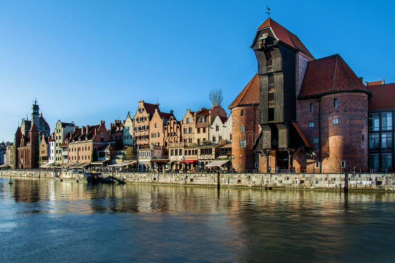 Famous historic Medieval port Crane Żuraw / Krantor - one of the Gdańsk water gates. Sunny morning on the Motlava River. Old tow. N Gdansk Gdańsk / stock photos