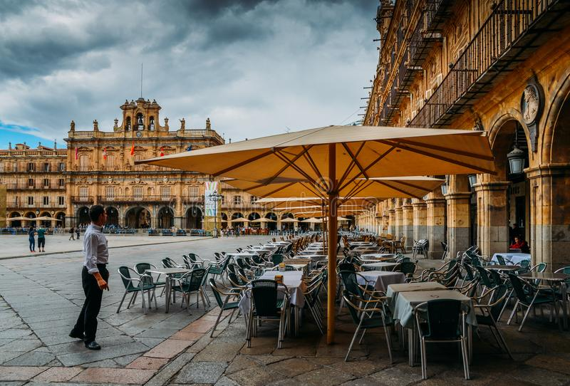 Famous and historic Plaza Mayor in Salamanca with dramatic clouds, Castilla y Leon, Spain - UNESCO World Heritage Site royalty free stock image