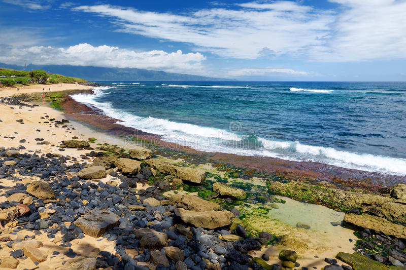 Famous Hookipa beach, popular surfing spot filled with a white sand beach, picnic areas and pavilions. Maui, Hawaii. Famous Hookipa beach, popular surfing spot stock photo