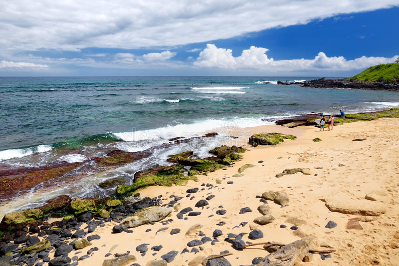 Famous Hookipa beach, popular surfing spot filled with a white sand beach, picnic areas and pavilions. Maui, Hawaii. Famous Hookipa beach, popular surfing spot stock photography