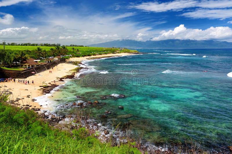 Famous Hookipa beach, popular surfing spot filled with a white sand beach, picnic areas and pavilions. Maui, Hawaii. Famous Hookipa beach, popular surfing spot royalty free stock image