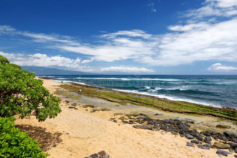Famous Hookipa beach, popular surfing spot filled with a white sand beach, picnic areas and pavilions. Maui, Hawaii. USA stock photography