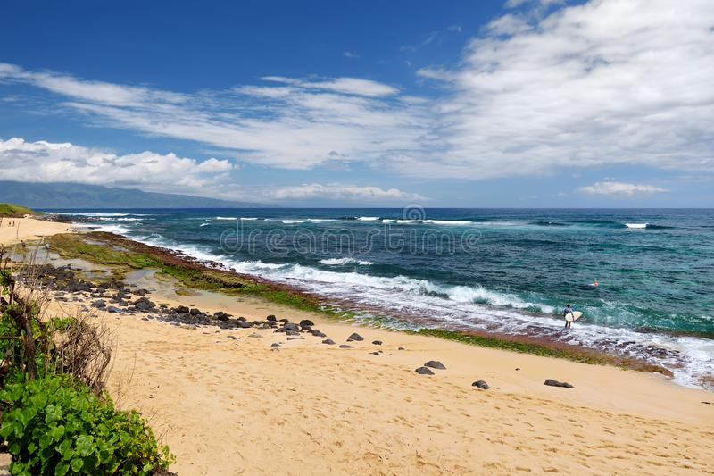Famous Hookipa beach, popular surfing spot filled with a white sand beach, picnic areas and pavilions. Maui, Hawaii. USA stock image
