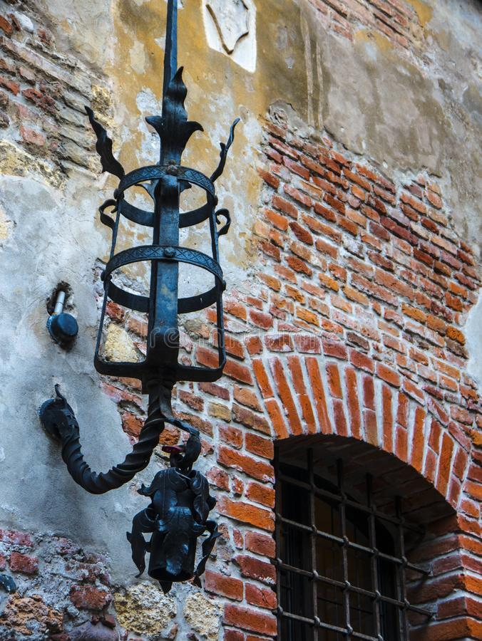 Torch bracket on Juliet`s house  in the city of Verona in northern Italy. The famous House of Juliet with its balcony in a small courtyard in the city of Verona royalty free stock photo