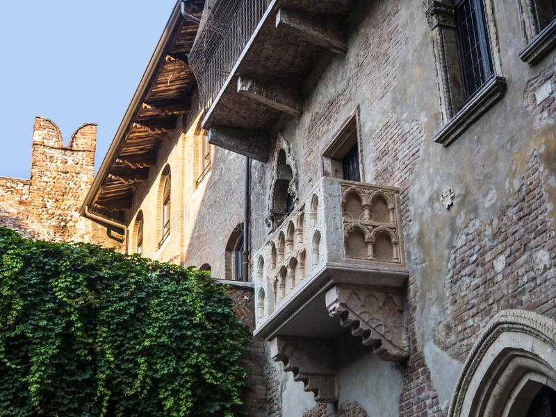 Juliet`s house  in the city of Verona in northern Italy. The famous House of Juliet with its balcony in a small courtyard in the city of Verona Italy is always stock photos