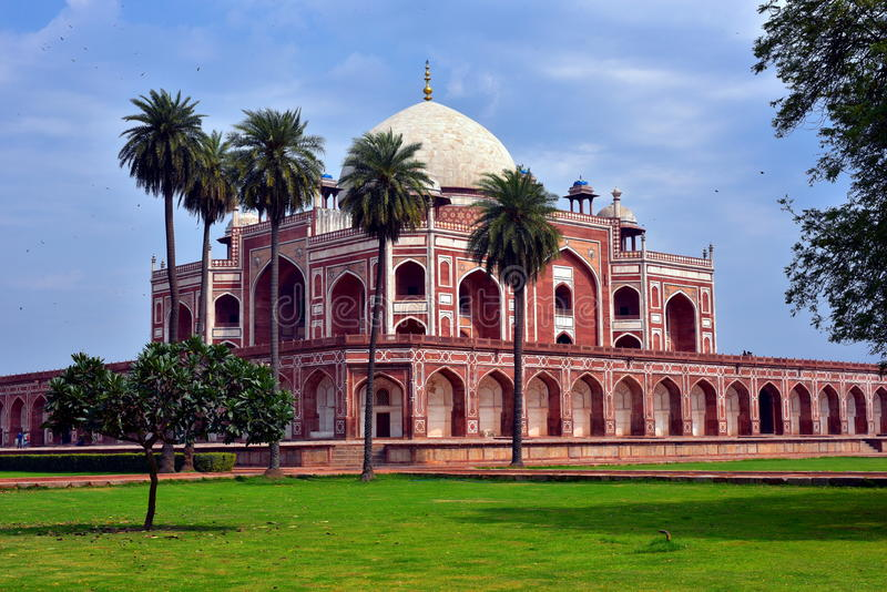 Famous Humayun's Tomb in Delhi, India. It is the tomb of the Mughal Emperor Humayun. It was commissioned by Humayun's son Akbar in 1569-70, and designed by stock photo