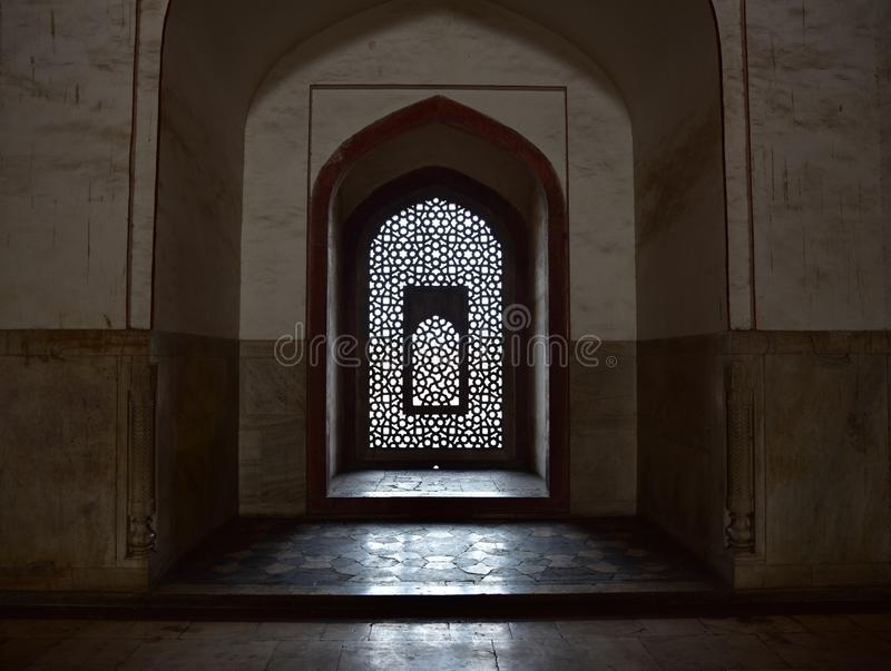 Famous Humayun's Tomb in Delhi, India. It is the tomb of the Mughal Emperor Humayun. It was commissioned by Humayun's son Akbar in 1569-70, and designed by royalty free stock photo