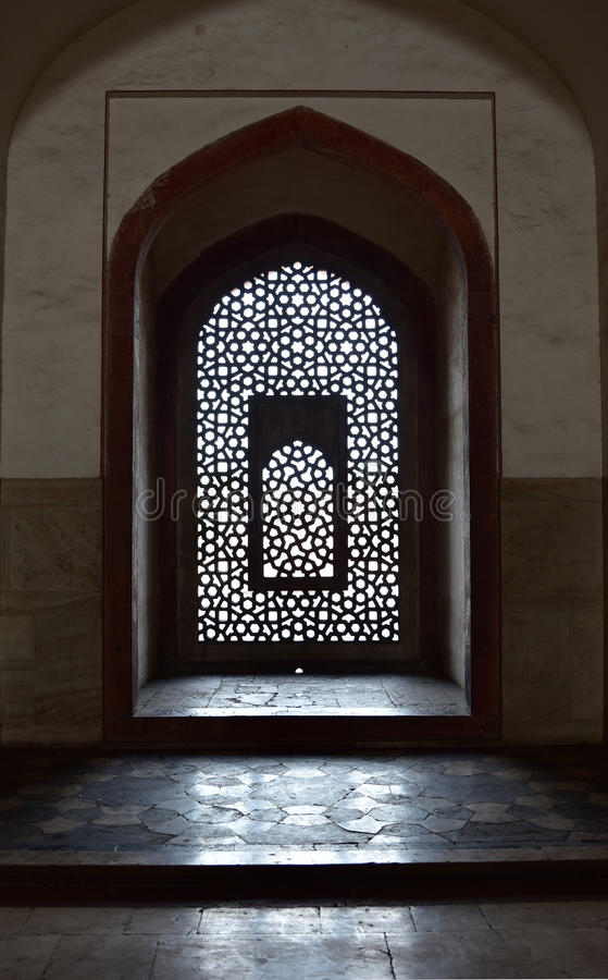Famous Humayun's Tomb in Delhi, India. It is the tomb of the Mughal Emperor Humayun. It was commissioned by Humayun's son Akbar in 1569-70, and designed by royalty free stock photos