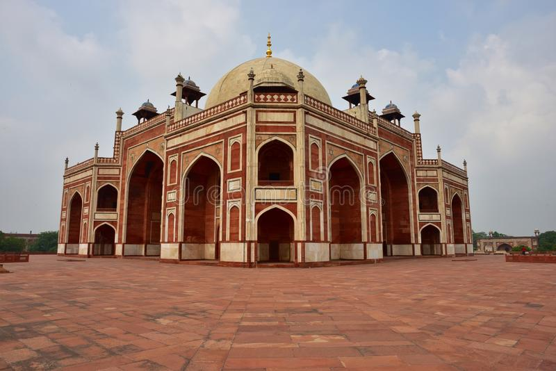 Famous Humayun's Tomb in Delhi, India. It is the tomb of the Mughal Emperor Humayun. It was commissioned by Humayun's son Akbar in 1569-70, and designed by stock images
