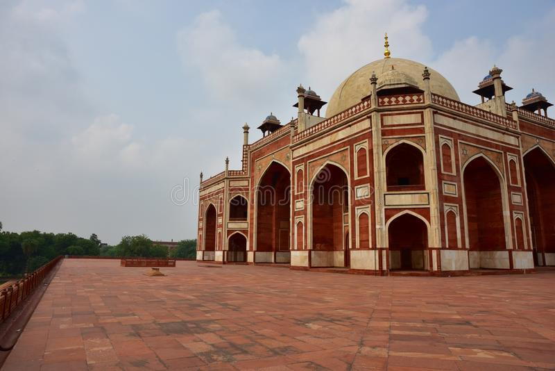 Famous Humayun's Tomb in Delhi, India. It is the tomb of the Mughal Emperor Humayun. It was commissioned by Humayun's son Akbar in 1569-70, and designed by royalty free stock photography
