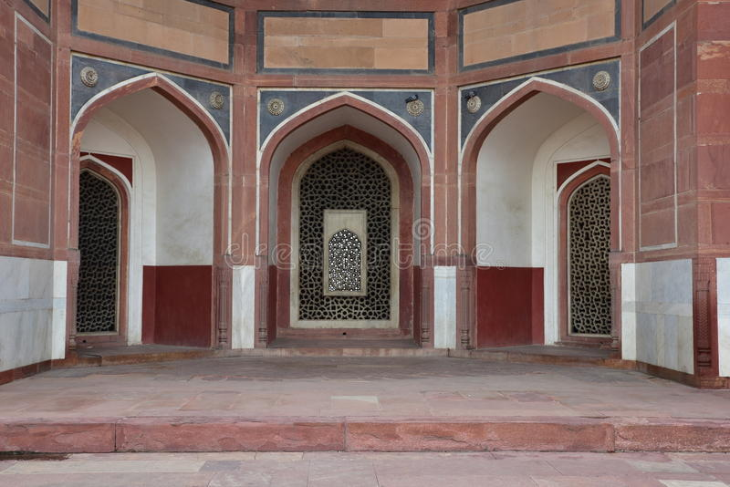 Famous Humayun's Tomb in Delhi, India. It is the tomb of the Mughal Emperor Humayun. It was commissioned by Humayun's son Akbar in 1569-70, and designed by stock photos